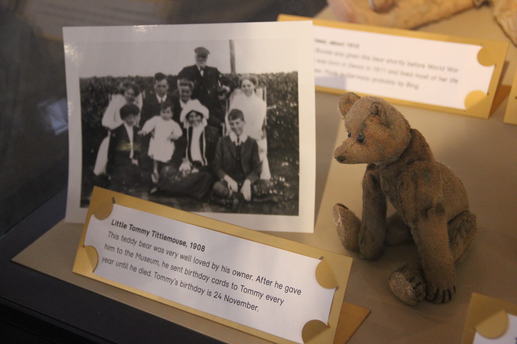 "From the V&A Museum of Childhood. The caption reads: ""Little Tommy Tittlemouse. This teddy bear was very well loved by his owner. After he gave him to the Museum, he sent birthday cards to Tommy every year until he died. Tommy's birthday is 24 November."" (Photo taken by me)."