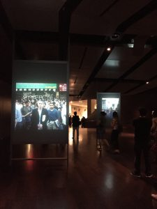 Display showing eyewitnesses to 911 watching from New York and around the world